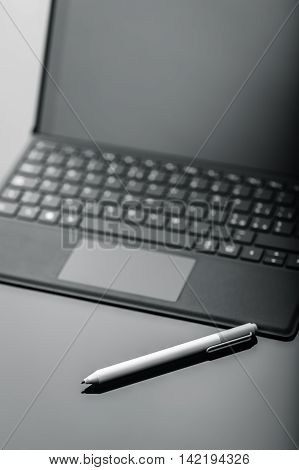 Tablet With Pen On Shiny Surface Detail
