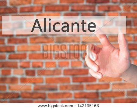 Alicante - Hand Pressing A Button On Blurred Background Concept On Visual Screen.