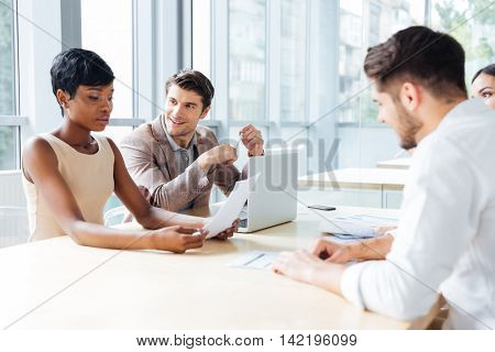 Businesspeople sitting at the table on a meeting at the office
