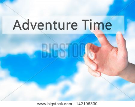Adventure Time - Hand Pressing A Button On Blurred Background Concept On Visual Screen.