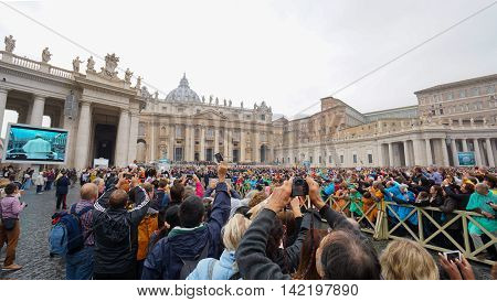 VATICAN CITY VATICAN -2015 OCTOBER 28: Pope Francis holds a General Audience on st. Peter's square filled with many pilgrims in Rome Italy on October 28 2015.