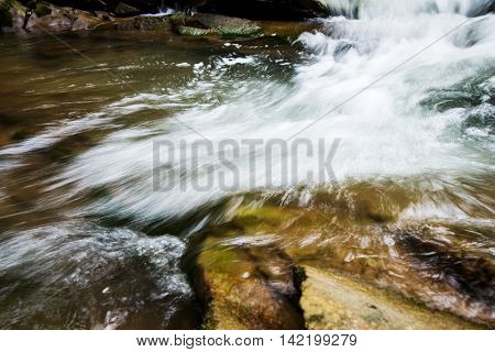 water loudly and quickly hurries on stone in mountains