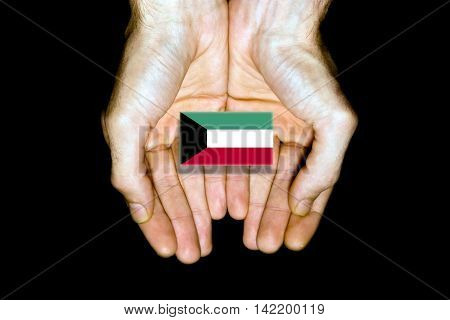 Flag Of Kuwait In Hands On Black Background