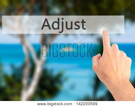 Adjust - Hand Pressing A Button On Blurred Background Concept On Visual Screen.