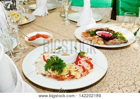 Dishes on a banquet table at restaurant