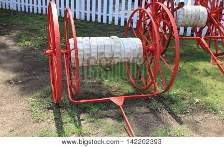 Antique Fire Hose and Two Wheeled Hose Reel