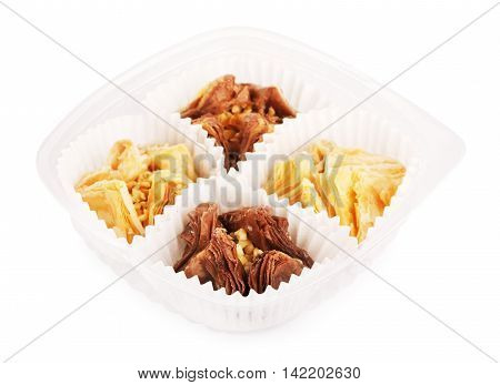 oriental sweets baklava in plastic pack, isolated on white background
