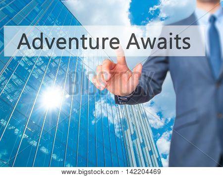 Adventure Awaits -  Businessman Press On Digital Screen.