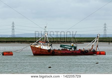 SHEERNESS, UK - JUNE 14: A local fishing boat is moored in the Swale estuary at Sheerness on June 14, 2013 in Sheerness. Kent has approx.131 licensed fishing vessels