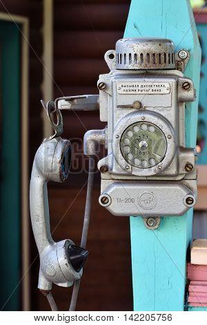 DEDILOVO RUSSIA - AUG 6 2016: Old soviet retro phone. Vintage mine dial telephone.