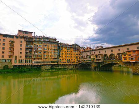 Ponte Vecchio bridge in Florence Italy. Arno River. Tuscany. Rainy day