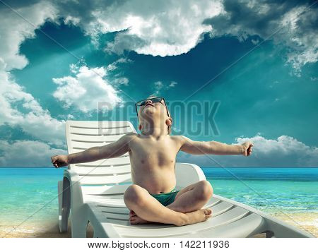 Boy under sunlight on the sea.
