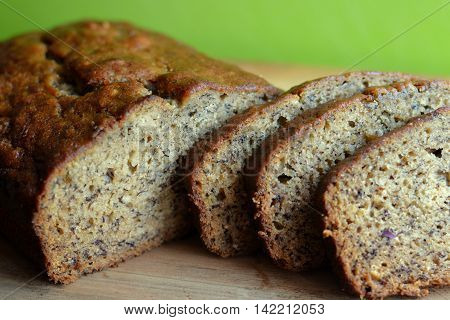 Banana Bread Loaf. Sliced on a wooden board