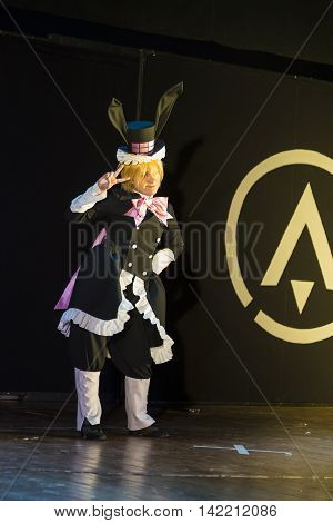Lviv Ukraine - May 232015: Woman dressed in the costume of the Rabbit performs on stage at the festival cosplay Anicon in Lviv May 23.2015