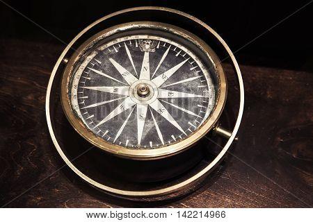 Vintage Compass On Dark Wooden Table