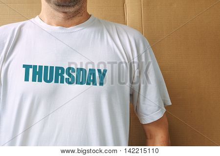 Days of the week - thursday man wearing white t-shirt with name of the fourth weekday printed