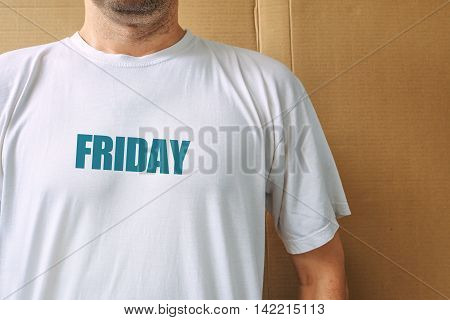 Days of the week - driday man wearing white t-shirt with name of the fifth weekday printed