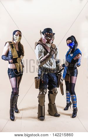 Lviv Ukraine - May 23.2015:Cosplayer boy and girls posing in a steampunk suit and a respirator mask Photo taken at cosplayers meeting indoor concert hall in Lviv city.May 23.2015