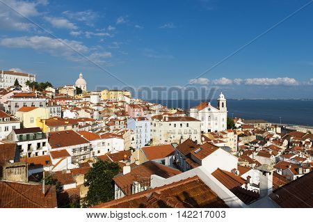 View of the Alfama neighborhood in Lisbon Portugal from the Portas do Sol viewpoint; Concept for travel in Lisbon Portugal
