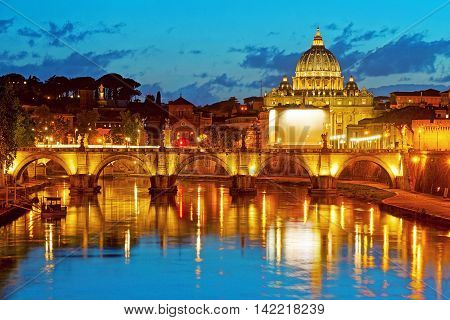 Night View at Saint Peter's Basilica and Bridge Sant'Angelo over Tiber River in Rome