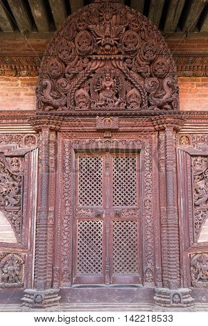 Bhaktapur, Nepal - December 04, 2014: Carved wooden door at Nyatapola Pagoda