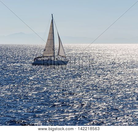 Sailing ship yachts with white sails in open sea