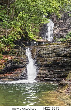 Deckertown Falls a tiered waterfall in Montour Falls New York splashes in multiple drops over rocky ledges.