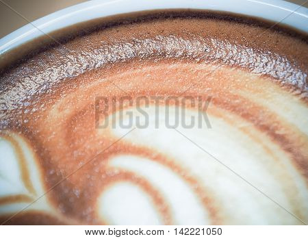 Macro image and selective focus / Cup of coffee latte art / Food and beverage concept