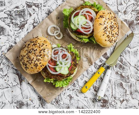 Healthy vegetarian zucchini fritters burgers on light background.