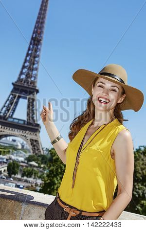Happy Woman Pointing On Eiffel Tower In Paris