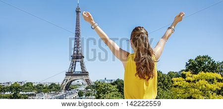 Young Woman In Bright Blouse Rejoicing In Paris, France