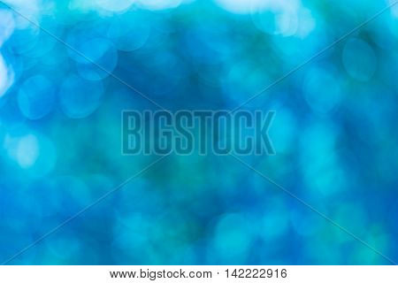 Abstract blue bokeh used as the background