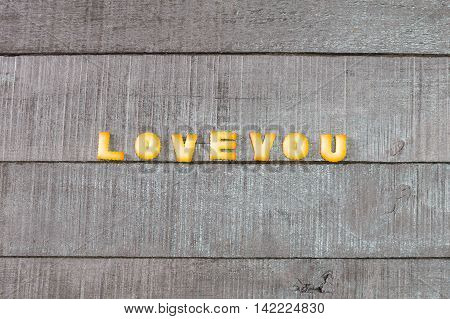 love you alphabet biscuit on wooden table stock photo