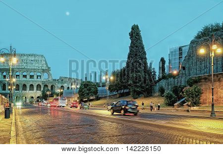 Colosseum In City Center Of Rome Italy In The Evening