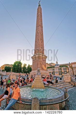 Tourists And Egyptian Obelisk At Piazza Del Popolo In Rome