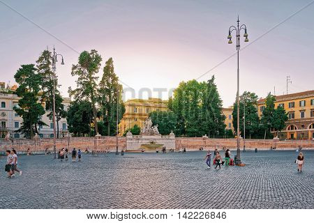 Tourists And Fountain In Piazza Del Popolo In Rome Italy