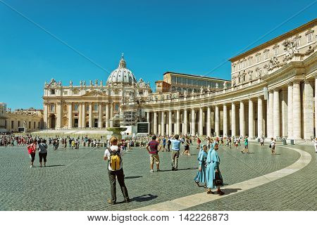 Tourists And Saint Peter Square In Vatican Of Italy