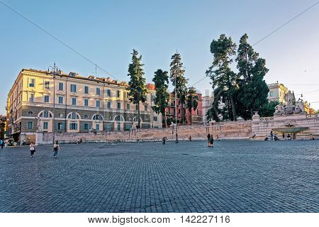 Tourists Near Fountain In Piazza Del Popolo In Rome Italy