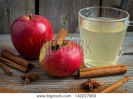 Dark Autumn composition of apples cinnamon and cider.