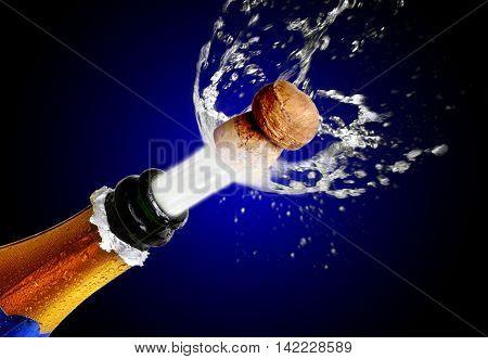 Explosion. Opening celebratory bottle of champagne with splashes