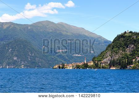 View towards lakeside village Varenna at Lake Como with mountains in Lombardy Italy