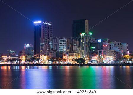 DA NANG, VIETNAM - JANUARY 06, 2016: City quay at night illumination in the late evening. Tourist landmark of the city Da Nang
