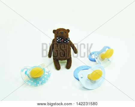 Small Teddy Bear toy with three baby nipple