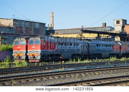 RYBINSK, RUSSIA - JULY 10, 2016: Two mainline freight diesel locomotive 2TE116 on in the locomotive depot station Rybinsk