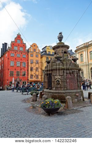 Stockholm, Sweden - 29 May 2016.  Tourists admire the famous square Stor Torget square. Houses Dating from the 17th Century in Stor-Torget, Stor Square.