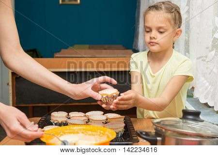 Daughter Helps Mum To Prepare Cupcakes For Easter