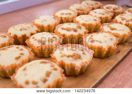 Freshly Baked Muffins Lie On A Wooden Tray
