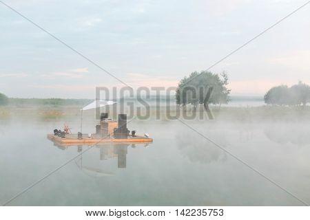 improvised scene with audio equipment on raft floating on river Ugra