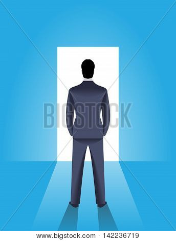 Shining opportunity business concept. Confident businessman stands in front of shining door. Bright light is coming from door and draws deep shadow behind men. Career opportunity luck and choice.