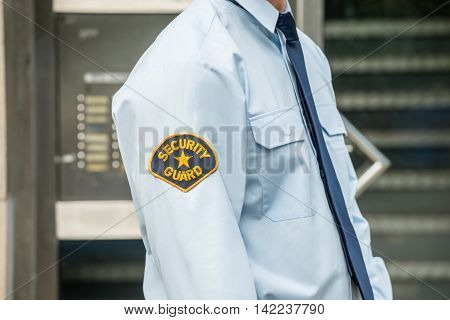 Close-up Photo Of Security Guard In Uniform